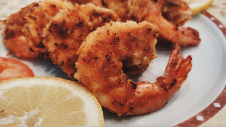 close-up view of restaurant-style breaded prawns