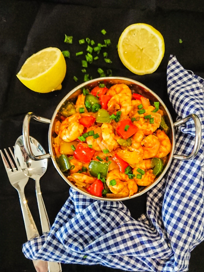 garlic prawns with peppers in a silver bowl