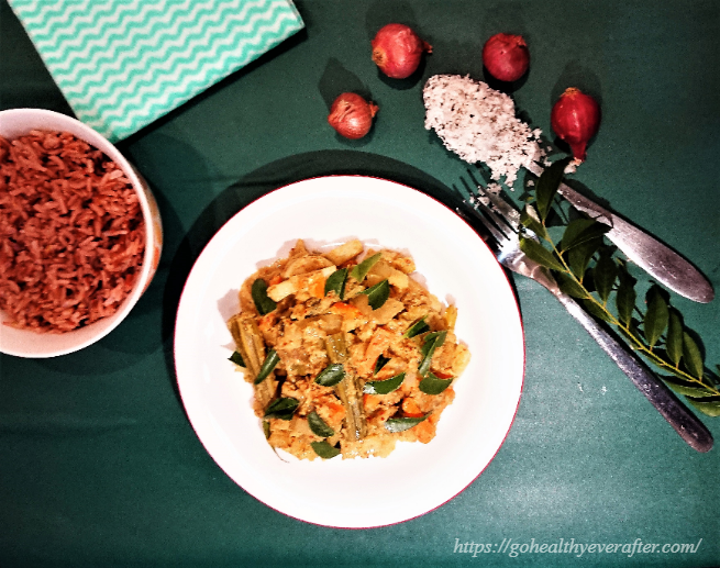 avial or boiled vegetables in coconut gravy and a bowl of red rice and some shallots and grated coconut strewn around