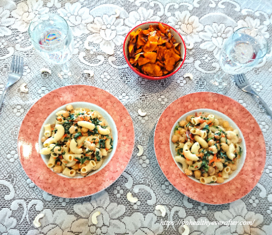 2 plates of creamy vegan chickpea pasta and a bowl of roasted pumpkin