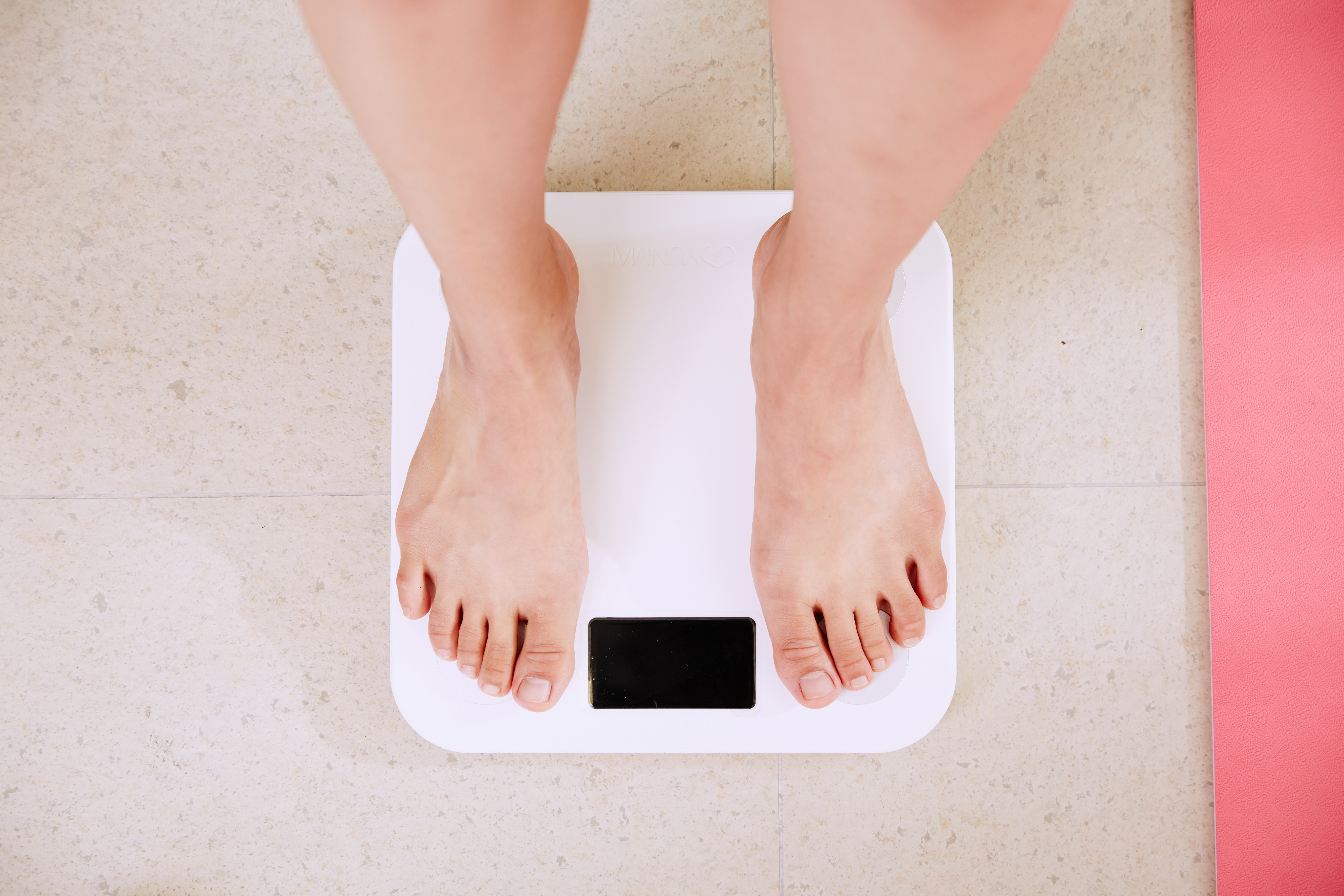 image of a pair of feet on a weighing scale