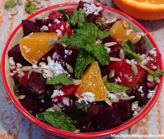 close-up view of beet orange salad in a ceramic bowl.