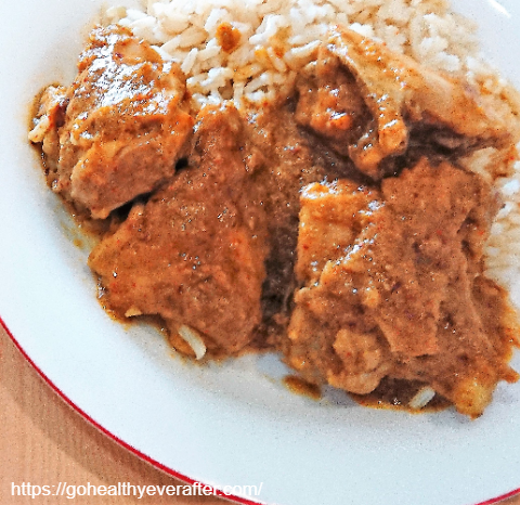 close-up view of 5-ingredient chicken curry with rice in a serving plate