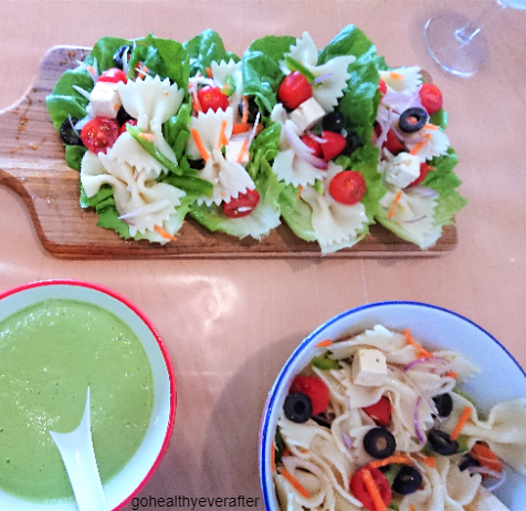 lettuce wraps with pasta salad and bowls of pasta salad and mint yogurt sauce