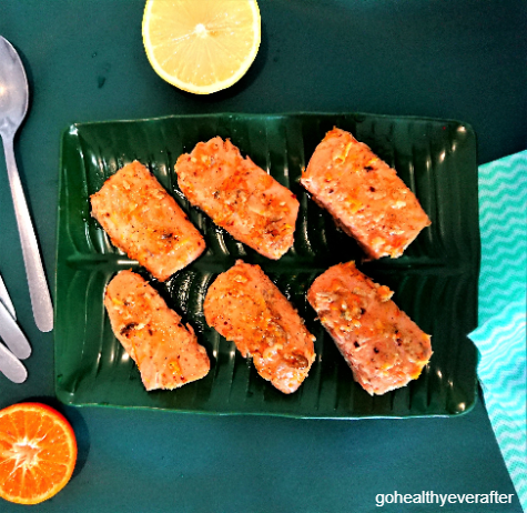 fillets of orange butter salmon on a green plate