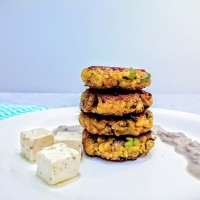 Cheesy quinoa patties with coconut-walnut sauce