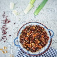 Asian stir-fried chicken with red beans and red rice