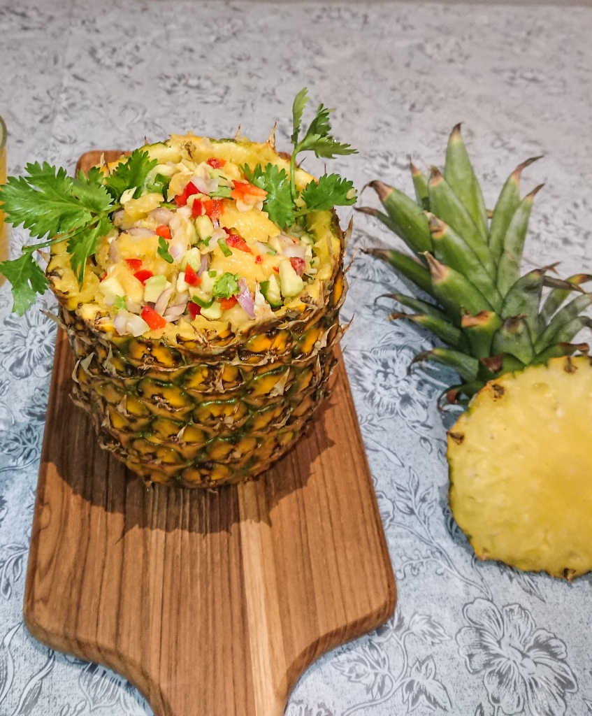pineapple avocado salsa in pineapple shell